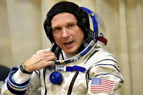 US astronaut Terry Virts speaks as his space suit is tested prior to blasting off to the International Space Station (ISS) on No