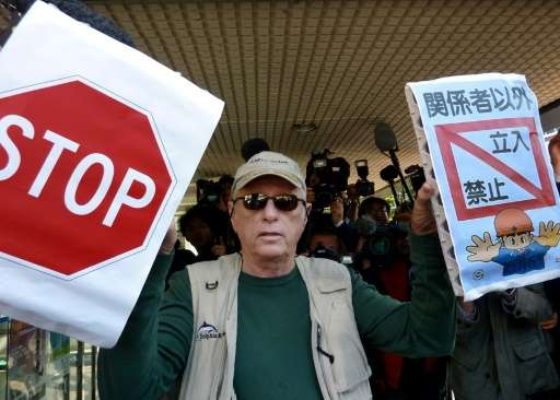 """US dolphin activist Ric O'Barry, the central figure in the Oscar-winning documentary """"The Cove"""", protests against dolp"""