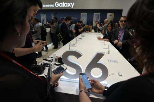 Visitors test Samsung Galaxy S6 smartphones on the opening day of the 2015 Mobile World Congress in Barcelona on March 2, 2015