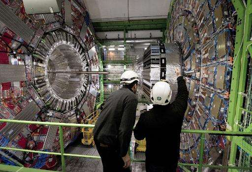 Workers check equipment at CERN in February, 2015