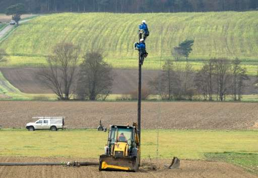 Workers service a local power line at the town of Guessing, where just 25 years ago was one of the poorest in Austria