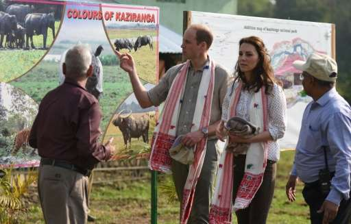 Britain's Prince William and Catherine, Duchess of Cambridge speak with Indian forest officials before leaving for a jeep safari