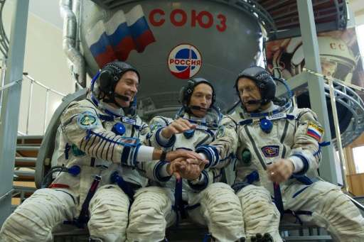 From L: US astronaut Shane Kimbrough and Russian cosmonauts Sergey Ryzhikov and Andrey Borisenko, pictured during preflight trai
