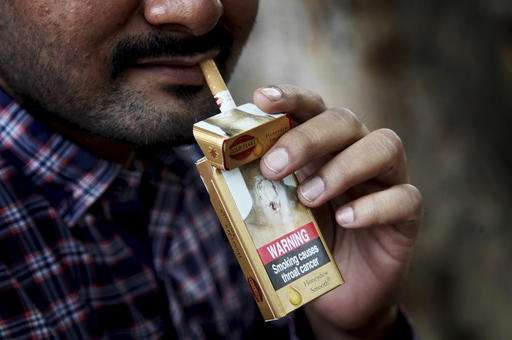 Global gov'ts: Make tobacco firms liable for smoking harm