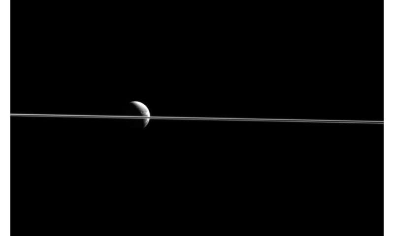Image: Saturn's rings dividing Dione