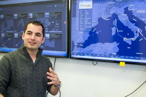 Israeli Ami Daniel, CEO and co-founder of the Windward company speaks in front of a screen as he poses at the company's offices