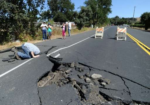 local resident inspects a buckled highway outside of napa california after earthquake struck the area in the early hours of august 24 2014