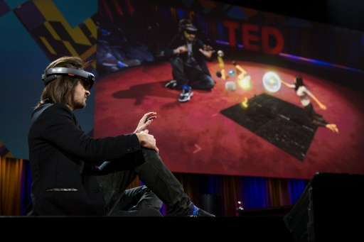 Microsoft inventor Alex Kipman demonstrates a HoloLens device at TED2016-Dream at the Convention Center in Vancouver