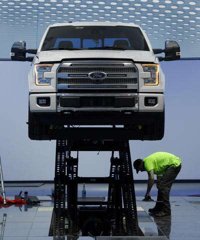 Muscle, glitz and a minivan: A look at Detroit auto show
