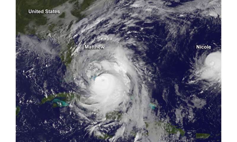 NASA sees Nicole dwarfed by Hurricane Matthew