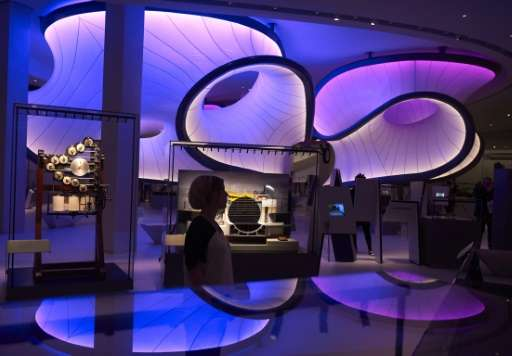 People walk through a new gallery, Mathematics: The Winton Gallery, inside the Science Museum during a press view in London on D