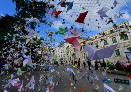 Thousands of paper birds installed by the Spanish section of the World Wildlife Fund are seen in front of the Parliament in Madr