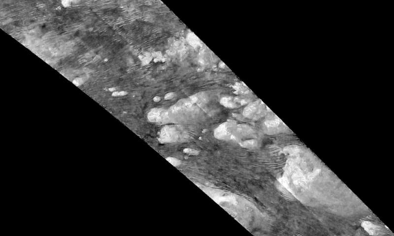 Titan's dunes and other features emerge in new images