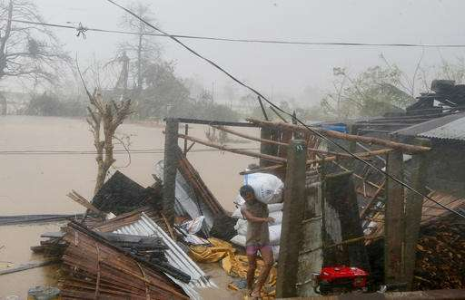 Typhoon Haima churns toward China after lashing Philippines