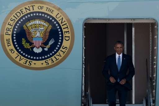 US President Barack Obama disembarks from Air Force One upon his arrival at Hangzhou Xiaoshan International Airport on September