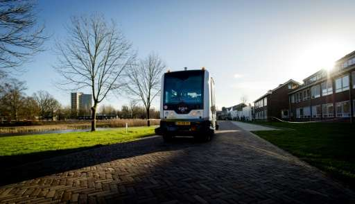 A picture taken in Wageningen, on January 28, 2016 shows the WEpod shuttle, designed to carry six people without a driver, runni