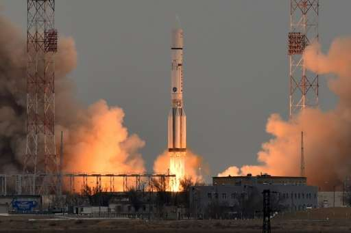 A Russian Proton-M rocket carrying the ExoMars 2016 spacecraft blasts off from the launch pad on March 14, 2016