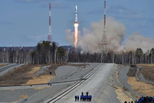 A Russian Soyuz 2.1a rocket, carrying Lomonosov, Aist-2D and SamSat-218 satellites, lifts off from the launch pad of the new Vos