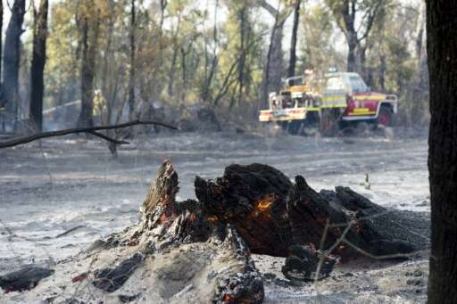 Firefighters say they have contained the bushfire which started by lightning six days ago and which has left a trail of destruct