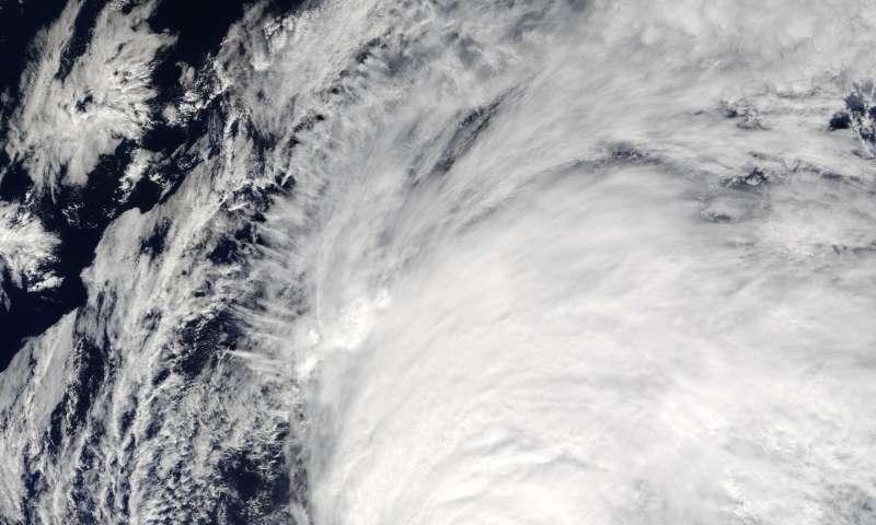 NASA sees large Hurricane Nicole moving past Bermuda