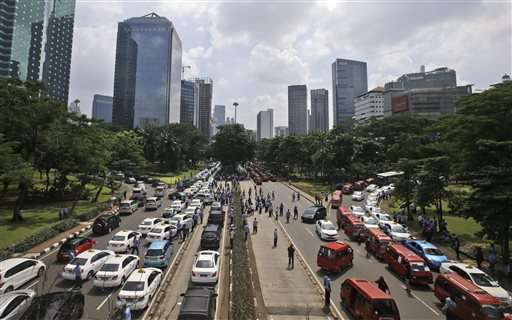 Protest against taxi apps causes chaos in Indonesia capital