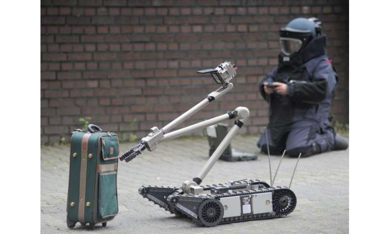 Remote-controlled robot inspects suitcase bombs