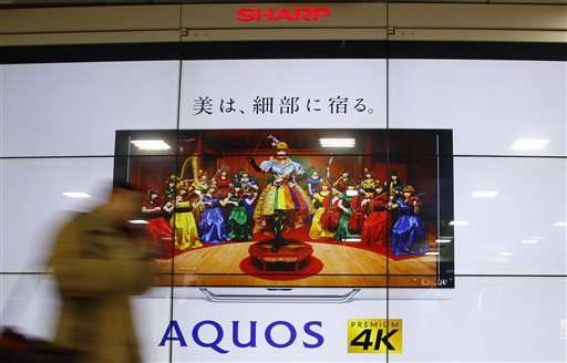 Japan's Sharp accepts takeover, Foxconn not ready to sign