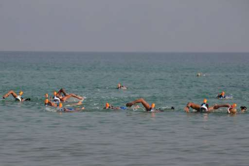 Participants take part in a 17-kilometre swim from Jordan to Israel across the Dead Sea, organised by the EcoPeace charity aimed