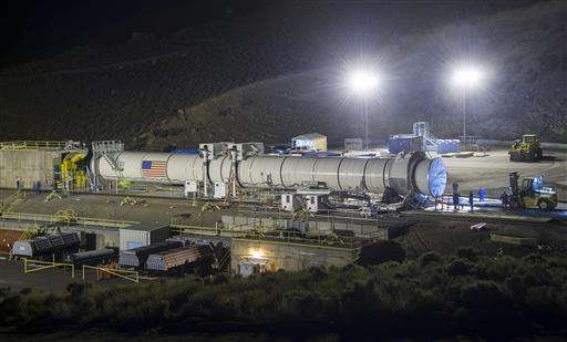 Booster rocket fires in key NASA test for Mars missions