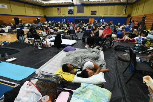 Local residents take shelter at the Pedro Menendez high school in St. Augustine, Florida, on October 6, 2016, ahead of Hurricane