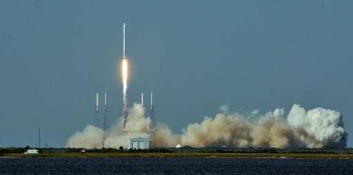 Space X's Falcon 9 rocket lifts off on April 8, 2016