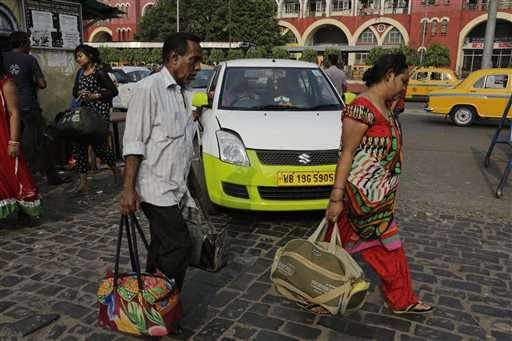 Uber, Ola face off in battle for India's booming taxi market