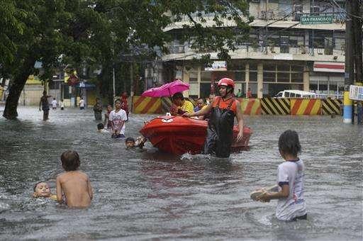 Typhoon drenches Taiwan, kills 2 people; floods hit Manila