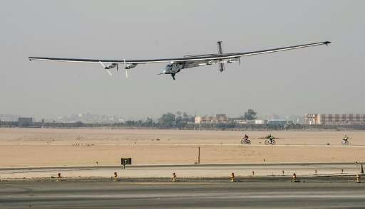 Solar-powered Solar Impulse 2 aircraft lands at Cairo International Airport on July 13, 2016, for the penultimate stage of its w