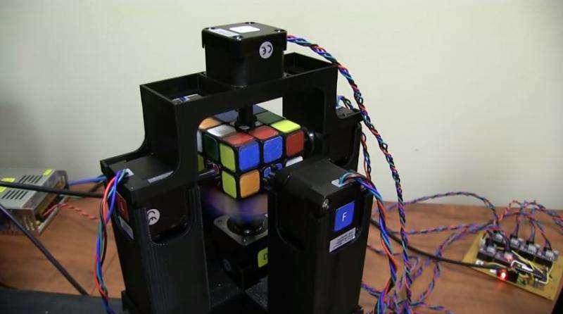 Record-seeking pair show off robot solving Rubik's Cube
