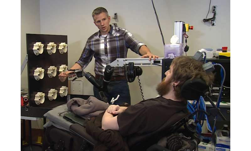 In a first, brain computer interface helps paralyzed man feel again