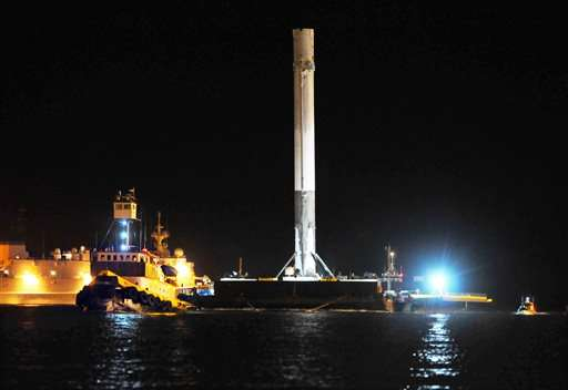 SpaceX's recovered rocket back at port after sea landing