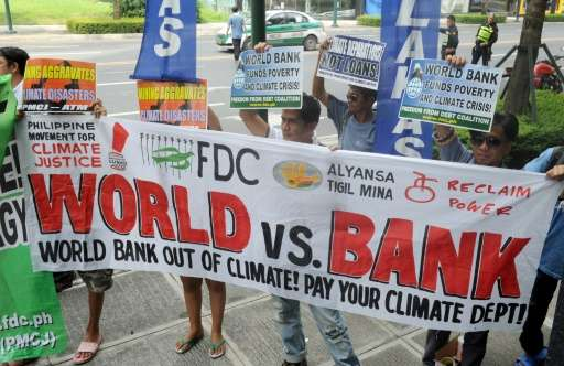 Members of the Freedom from Debt Coalition lead a protest in front of the World Bank office in Bonifacio Global City in suburban