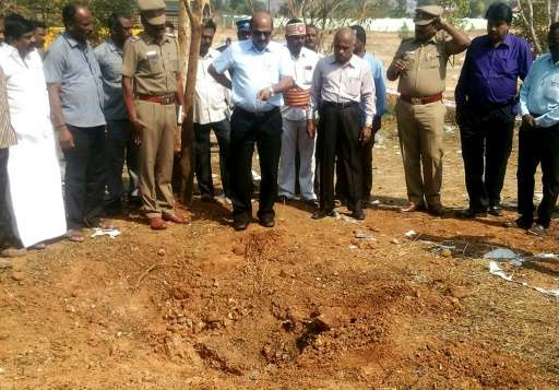 Scientists inspect the crash site of a suspected meteorite that landed in the Vellore district of Tamil Nadu state, southern Ind