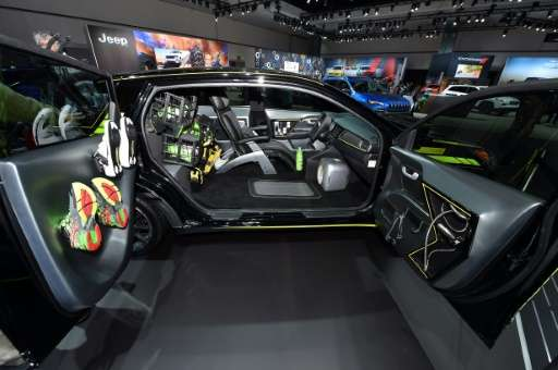 A 2017 Kia Niro Triathlete Inspired autonomous concept car with a shower head in the passenger door is on display at the Los Ang