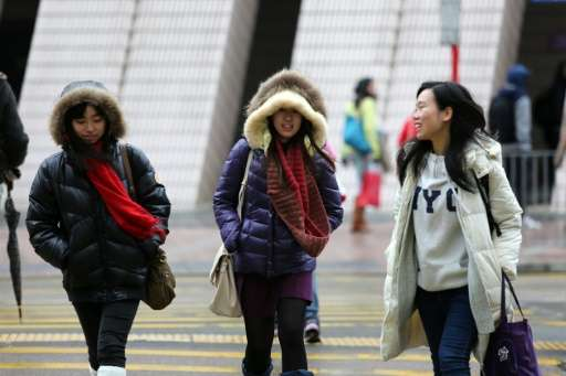 A cold snap gripped Hong Kong on January 24, with residents shivering as temperatures plunged to the lowest point in nearly 60 y