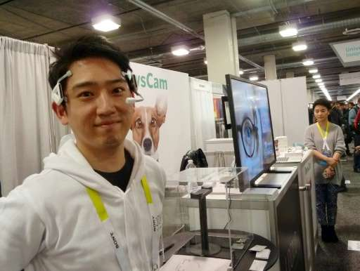 Alex Chang of Looxid Labs demonstrates a brainwave headset at the Consumer Electronics Show on January 7, 2016 in Las Vegas, Nev