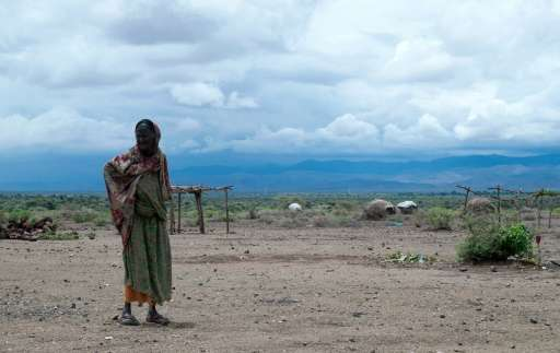 An elderly pastoralist woman walking in Sitti Zone, in the Somali Region of Ethiopia on April 16, 2016