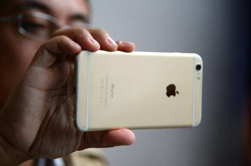Apple shares were down more than six percent to $93.80 in late trade as investors grappled with news of slowing sales growth of