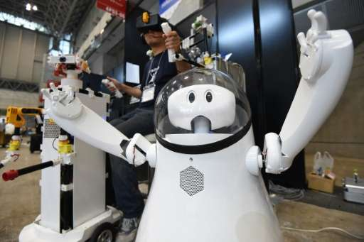 "A prototype remote-controlled robot called ""Caiba"" is demonstrated by developer Katsumori Sakakibara (L) during a pres"