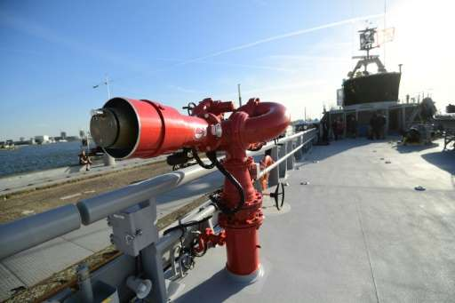 A red cannon on the Ocean Warrior's bridge can eject a powerful plume of water to obstruct the views of the whalers, or block th