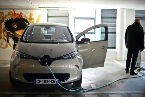 A Renault Zoe electric car at a charging point in Lisbon
