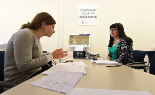 A resident (L) discusses her housing situation with a SoCal Gas employee at the SoCal Gas Community Resource Center in Porter Ra