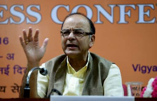 Arun Jaitley says the sale of mobile phone licenses may be India's largest ever auction