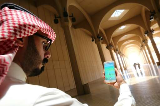 A Saudi man plays with the Pokemon Go application on his mobile in Riyadh on July 17, 2016